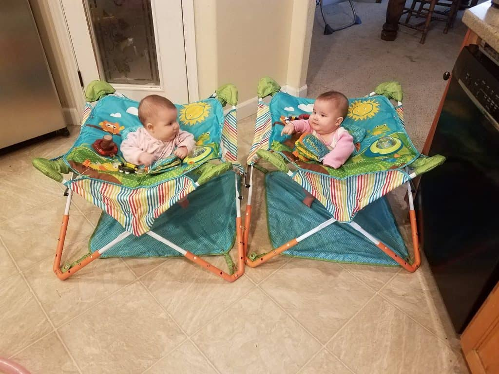 My girls in their portable jumpers; perfect for taking baby camping so they can see everything going on!