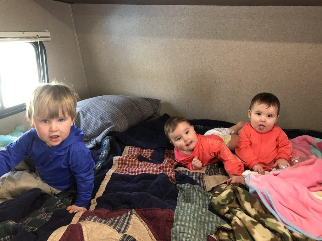 camping tips for newborns and toddlers use the queen bed to play on during the day