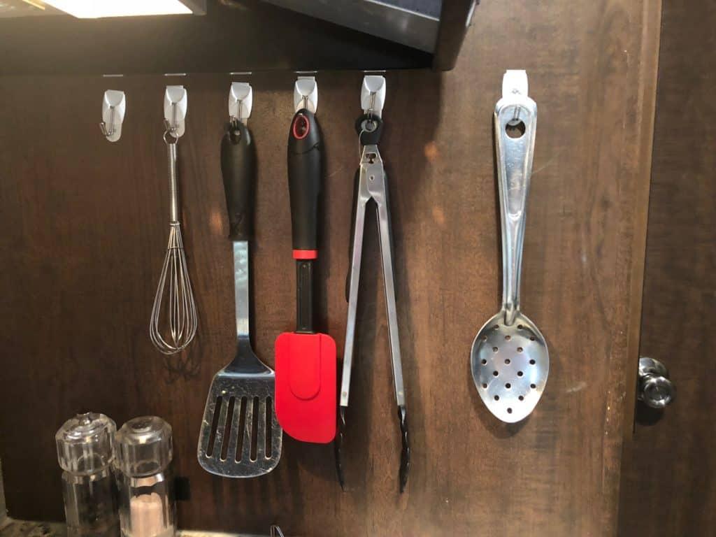 3m hooks to organize rv kitchen utensils