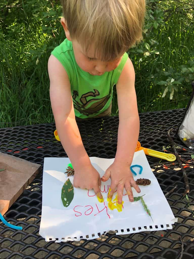 camping tradition for kids, making a sign for your campsite!