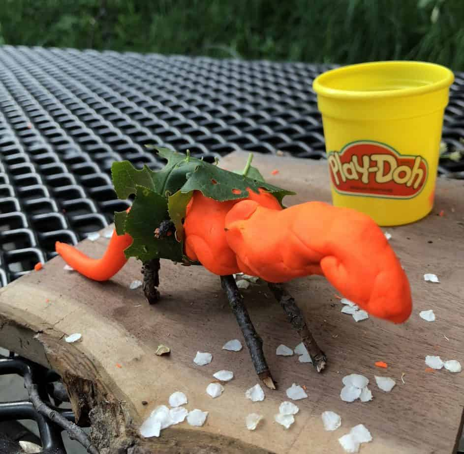playdoh craft idea using items found in nature to make a dino