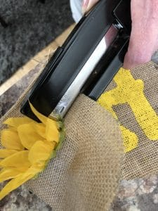attach flowers to banner with a stapler