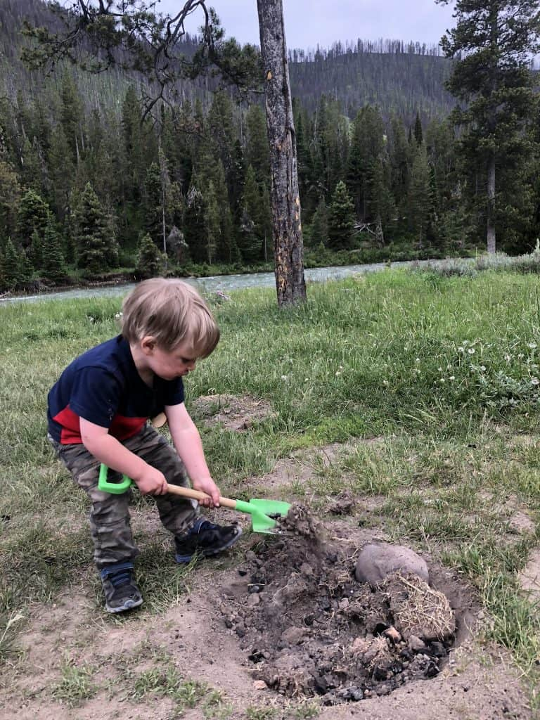 digging a hole for kids is a fun kids camping activity