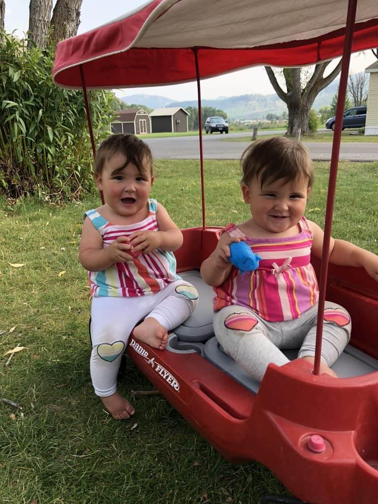 twin girls in wagon
