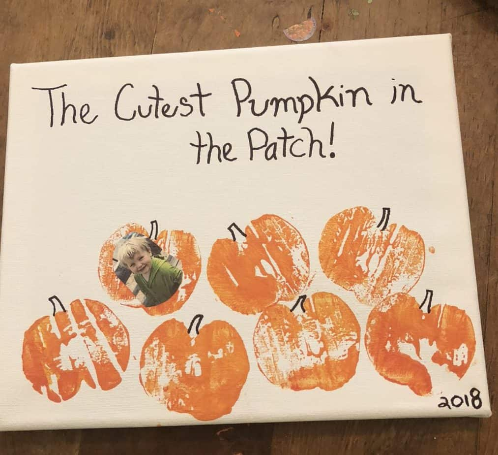 kids picture in pumpkin craft