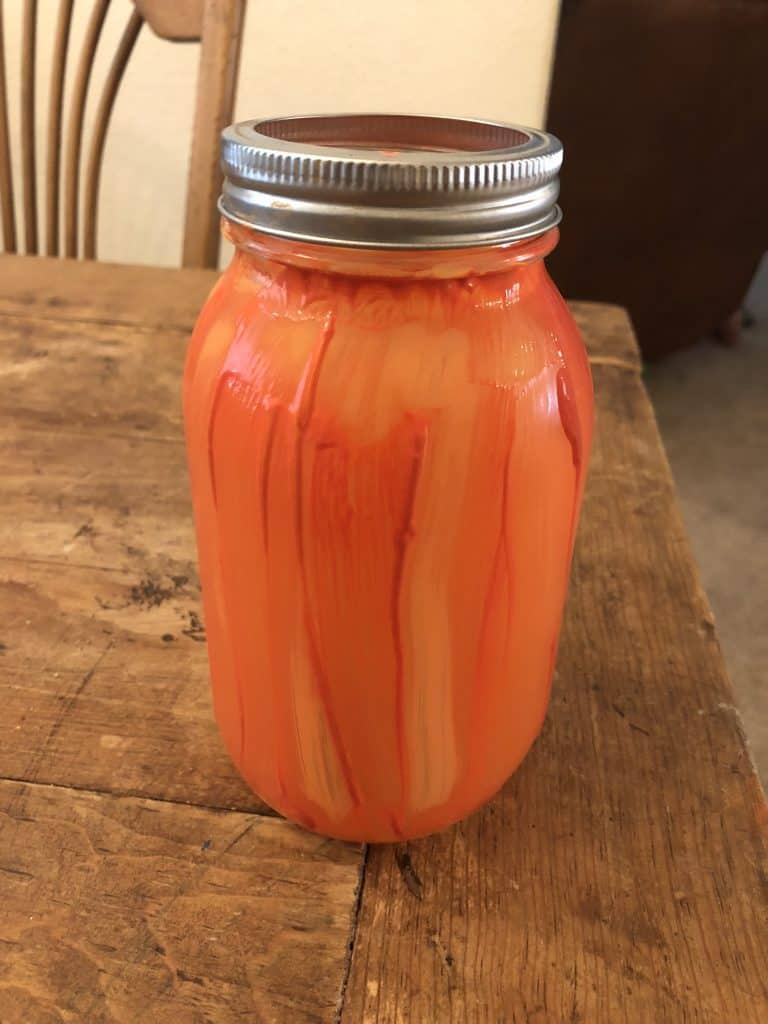 mason jar painted like a pumpkin