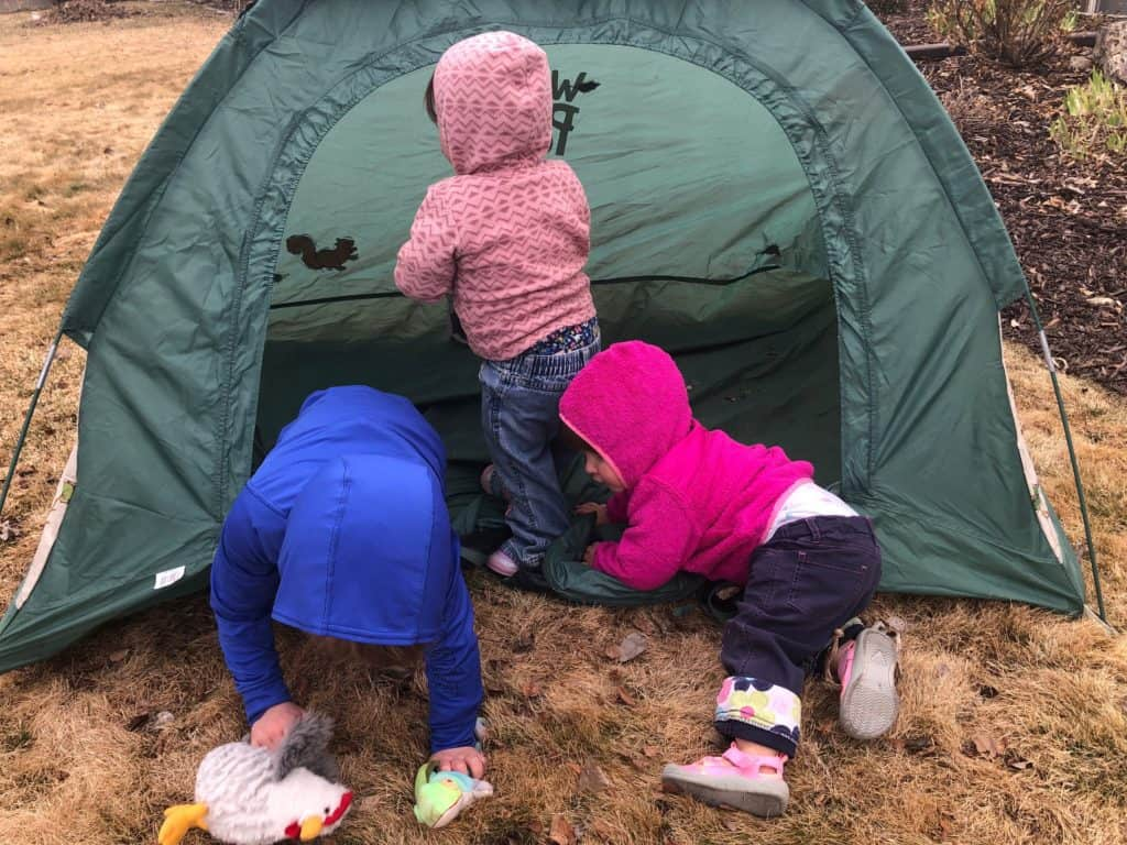 camping with kids tip - use a play tent for shade and to contain toys
