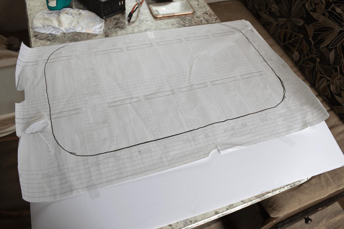 tape rv window cover outline to foam board