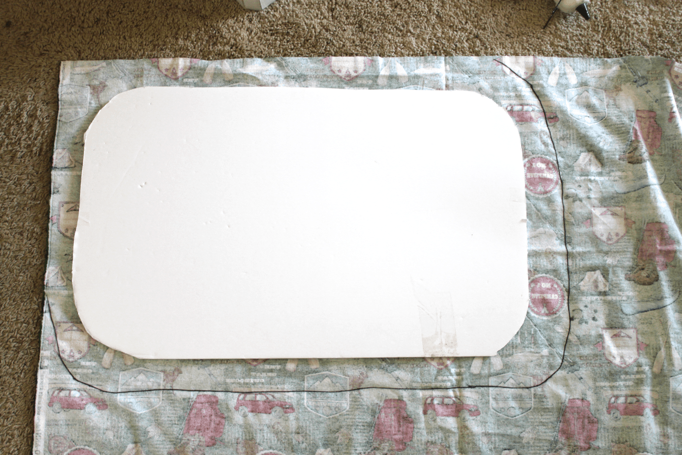 trace around foam board to leave enough material to glue on other side for camper windows