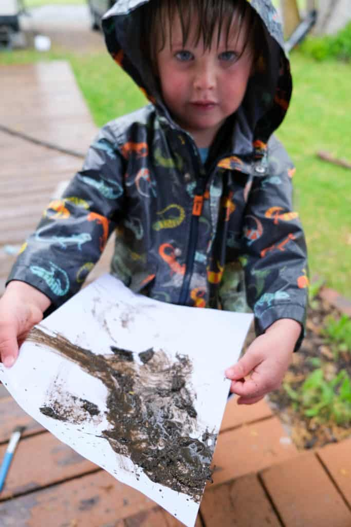 mud painting for rainy day fun outside with kids