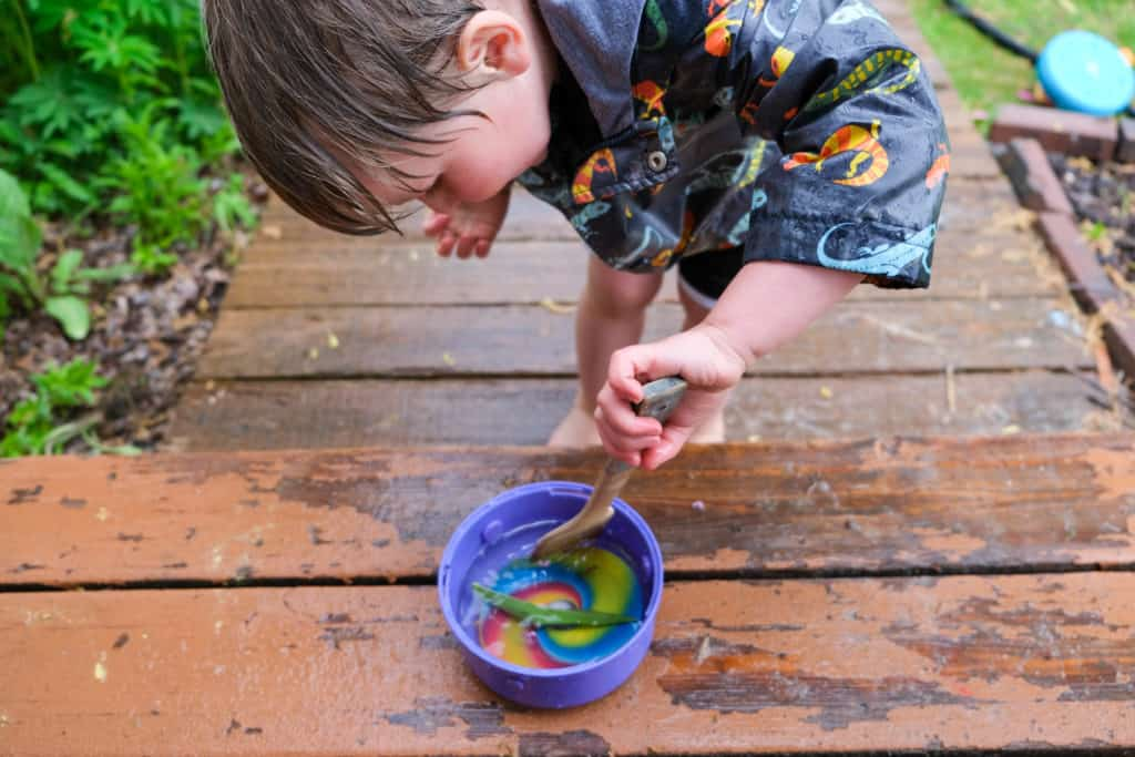 make rain soup for outdoor rain activity with kids