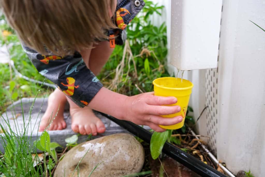 collect rain water with various containers for outdoor rain activity
