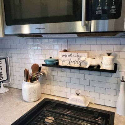 white subway tile in kitchen of camper
