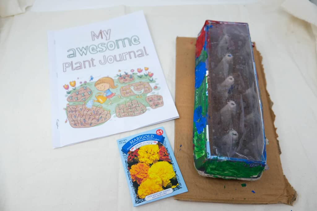 easy gardening spring activity for kids with journal and greenhouse