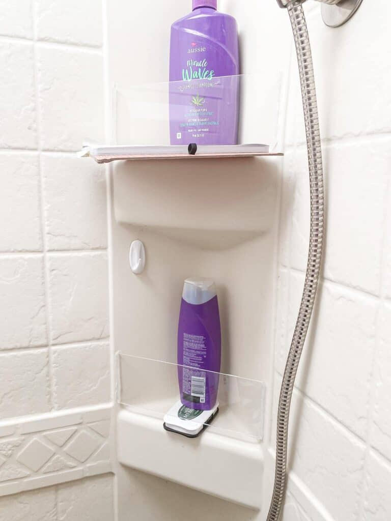 diy way to organize camper shower with plexi glass and silicone