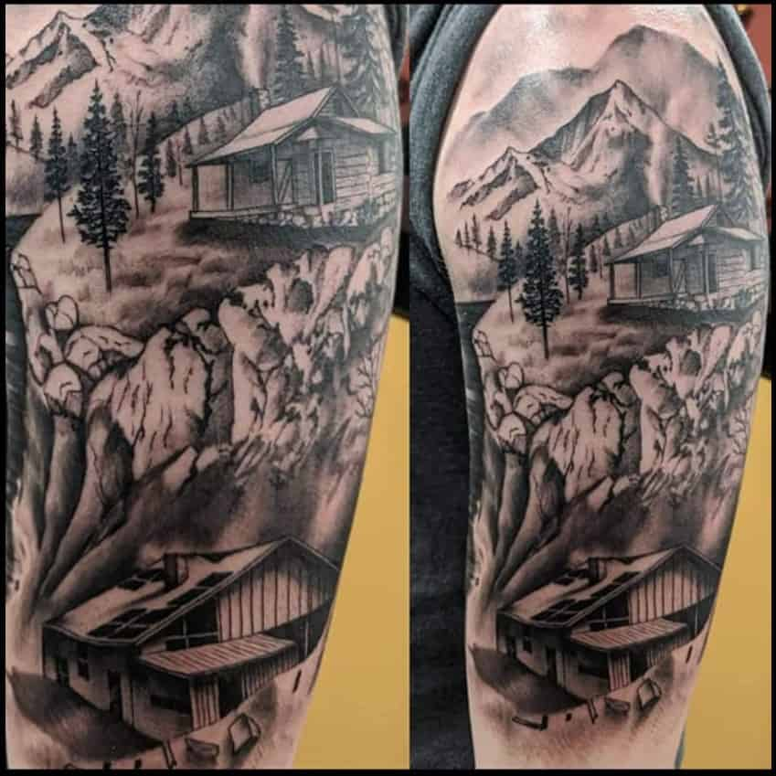 mountain cabin black and white shoulder tattoo